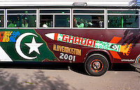 © Piers Benatar/Panos Pictures..Rawalpindi, Pakistan. 2001...Pakistan is very proud of its status as the only Muslim nuclear power, a pride which manifests itself in sculptures, murals and merchandising paraphernalia depicting its Ghauri and Shaheen missiles. Here, the missile adorns the side of a bus.