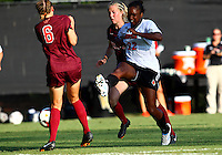WINSTON-SALEM, NORTH CAROLINA - August 30, 2013:<br />  Christine Exeter (22) of Louisville University blasts a shot off Jodie Zelenky (6) of Virginia Tech during a match at the Wake Forest Invitational tournament at Wake Forest University on August 30. The game ended in a 1-1 tie.