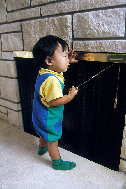 Palo Alto CA Boy (Japanese) one-year-old, showing ability to manipulate screen by pulling chain (cause and effect) MR