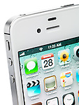 Closeup of a white iPhone 4s Apple smartphone