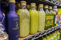 Bottles of imported olive oil showing signs of coagulation from storage at a low temperature are seen on a supermarket shelf in New York on Thursday, February 20, 2014. (© Richard B. Levine)