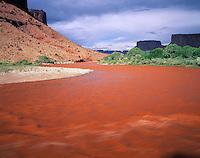 Flood run-off turning Colorado River Orange, Utah   Near Moab, Utah