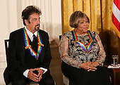 Actor Al Pacino, and singer Mavis Staples listen to United States President Barack Obama during a ceremony for 2016 Kennedy Center Honorees, in the East Room of the White House, December 4, 2016, Washington, DC. Other honorees include pianist Martha Argerich,  singer James Taylor and Eagles band members Don Henley, Timothy B. Schmit, Joe Walsh. <br /> Credit: Aude Guerrucci / Pool via CNP