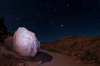 Flashlit Boulder Under Desert Stars, Arches National Park, Utah, US