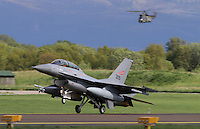 Norwegian F-16 B lands as a Puma helicopter flies in the background. Nato Tiger Meet is an annual gathering of squadrons using the tiger as their mascot. While originally mostly a social event it is now a full military exercise. Tiger Meet 2012 was held at the Norwegian air base Ørlandet.