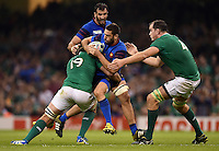 Remi Tales of France takes on the Ireland defence. Rugby World Cup Pool D match between France and Ireland on October 11, 2015 at the Millennium Stadium in Cardiff, Wales. Photo by: Patrick Khachfe / Onside Images