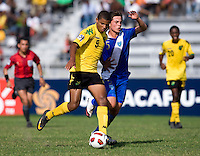 Omar Holness (9) of Jamaica holds off Julio Ortiz (5) of Guatemala during the group stage of the CONCACAF Men's Under 17 Championship at Catherine Hall Stadium in Montego Bay, Jamaica. Jamaica defeated Guatemala, 1-0.