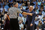 18 January 2015: Virginia Tech head coach Buzz Williams (right) argues with referee Michael Stuart (left). The University of North Carolina Tar Heels played the Virginia Tech University Hokies in an NCAA Division I Men's basketball game at the Dean E. Smith Center in Chapel Hill, North Carolina. UNC won the game 68-53.