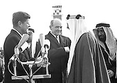 United States President John F. Kennedy, left, and US Secretary of State Dean Rusk, center left, welcome King Saud bin Abdulaziz Al Saud of Saudi Arabia, center right, to the United States following a ceremony at Andrews Air Force Base, Maryland on February 13, 1962.  <br /> Credit: Arnie Sachs / CNP