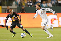 CARSON, CA – May 7, 2011: LA Galaxy midfielder David Beckham (23) moves past New York Red Bull midfielder Dane Richards (19) during the match between LA Galaxy and New York Red Bull at the Home Depot Center, May 7, 2011 in Carson, California. Final score LA Galaxy 1, New York Red Bull 1.