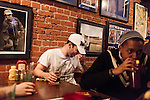 January 23, 2013. Durham, North Carolina. Mark Kayello (left) a Duke student and member of the Kappa Sigma fraternity watches in disgust as Duke lost a 63-90 blowout to Miami. He and his frat brothers had gathered at Charlie's Pub and Grille to watch the game.. Duke University has become a power house in the national college basketball arena under the coaching of head coach Mike Krzyzewski. But the university has fought hard to maintain its image of high academic achievement while riding the wave of collegiate athletic success.