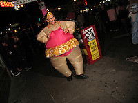 "Halloween in The Castro, San Francisco, CA. A man dressed as ""the fat lady"", spent most of his time bouncing around on the sidewalk."