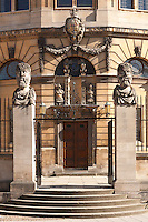 Emperors Heads, Sheldonian theatre, Broad St, Oxford. The official name for such heads is &quot;herms&quot;; the original accounts describe these heads as &quot;termains&quot;; and some people call them philosophers. But Max Beerbohm in Zuleika Dobson called them &quot;Emperors&quot;, and that is the name that has stuck. Each head shows a different type of beard. The present heads are the third set carved between 1970 and 1972 by Michael Black. The first set lasted 200 years, but by 1868 they were crumbling and new ones were erected; undergraduates, however, daubed these in paint, and the harsh cleaning they received caused them to wear badly, so that they could be described by John Betjeman (in his verse autobiography Summoned by Bells) as &quot;the mouldering busts round the Sheldonian&quot; when he came up in 1925.