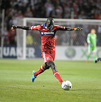 Chicago Fire forward Dominic Oduro (8) lunges to push the ball forward.  The Chicago Fire defeated the Philadelphia Union 1-0 at Toyota Park in Bridgeview, IL on March 24, 2012.