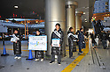 March 22, 2011, Kawasaki City, Kanagawa Prefecture, Japan - Professional soccer players from Kawasaki Frontale, a J-League soccer team from Kawasaki, Kanagawa Prefecture, Japan, pitch in to gather donations for survivors of the 2011 Tohoku-Kanto Natural Disaster. The J-League season will be paused for a month and a half due to damage sustained in the earthquakes and tsunamis. (Photo by Atsushi Tomura/AFLO)