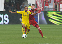 July 20, 2013: Toronto FC defender Steven Caldwell #13 and Columbus Crew forward Federico Higuain #33 in action during a game between Toronto FC and the Columbus Crew at BMO Field in Toronto, Ontario Canada.<br /> Toronto FC won 2-1.