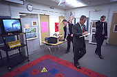 United States President George W. Bush listens to news coverage of the World Trade Center terrorist attack at Emma Booker Elementary School in Sarasota, Florida, Tuesday, September 11, 2001..Mandatory Credit: Eric Draper - White House via CNP.