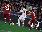 Calcio, Serie A: Roma vs Milan. Roma, stadio Olimpico, 22 dicembre 2012..AC Milan forward Stephan El Shaarawy, center, is challenged by AS Roma's defender Ivan Piris, left, and midfielder Miralem Pjanic during the Italian Serie A football match between AS Roma and AC Milan at Rome's Olympic stadium, 22 December 2012..UPDATE IMAGES PRESS/Isabella Bonotto