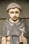 Ceramic garden art of a young religious figurine