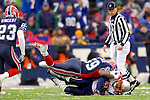 New England Patriotsrunningback Corey Dillon (28) is tackled by linebacker London Fletcher (59) after a gain against the Buffalo Bills at Ralph Wilson Stadium in Orchard Park, NY, on December 11, 2005 . The Patriots defeated the Bills 35-7. Mandatory Photo Credit: Ed Wolfstein