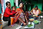 Asia, India, Khajuraho. Local village family in their home in Khajuraho, India.