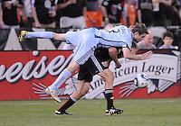 Colorado Rapids defender Drew Moor (3) fouls DC United forward Adam Cristman (7). The Colorado Rapids defeated DC United 1-0 at RFK Stadium, Saturday May 15, 2010.