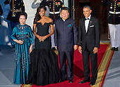 United States President Barack Obama, right, and First Lady Michelle Obama, second left, welcome President XI Jinping of China, second right, and Madame Peng Liyuan, left, to a State Dinner in their honor on the North Portico of the White House in Washington, DC on Friday, September 25, 2015.<br /> Credit: Ron Sachs / CNP