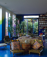 The open-plan kitchen/living area is surrounded on all sides by the roof terrace and has a deep blue floor and walls