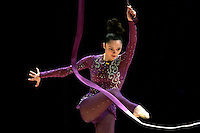 Anna Bessonova of Ukraine (here kicking ribbon away to later re-catch baton) wins Gold, Silver and Bronze in rhythmic gymnastics apparatus finals at World Games from Duisburg, Germany on July 20-21, 2005.  Event finals in rhythmic gymnastics are only held at World Games. (Photo by Tom Theobald)