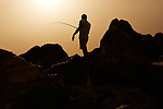 Netanya. A man fishes on the beach