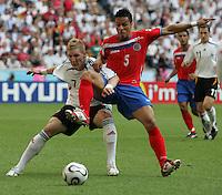 JUNE 9, 2006: Munich, Germany: German midfielder (7) Bastian Schweinsteiger tries to hold off Costa Rican defender Gilberto Martinez (5) during the World Cup Finals in Munich, Germany.  Germany defeated Costa Rica, 4-2.
