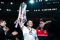 Dylan Hartley of England lifts the Six Nations trophy in celebration after the match. RBS Six Nations match between France and England on March 19, 2016 at the Stade de France in Paris, France. Photo by: Patrick Khachfe / Onside Images