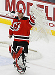 Mar 17, 2009; Newark, NJ, USA; New Jersey Devils goalie Martin Brodeur (30) holds up the net after the Devils defeated the Blackhawks 3-2.  With the win, Martin Brodeur became the all-time winningest goalie in NHL history with his 552 win.