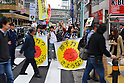 Tokyo, Japan - April 15: Pedestrians walked by an anti-nuclear power plants demonstration at Ikebukuro, Toshima, Tokyo, Japan on April 15, 2012. This was the first time in the big city and organized by a local couple, Mr. and Mrs. Makabe. It was promoted via twitter and its blog, and approximately 250 people showed up.