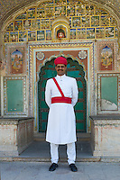 Ceremonial Guard at Samode Haveli luxury hotel, former merchant's house, in Jaipur, Rajasthan, Northern India