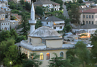 Octagonal madrasa built in 1727 originally the Bektashi Teqe, and the minaret of the Mosque, part of Memi Pasha's original 17th century plan for the Bazaar, destroyed by fire and rebuilt c. 1757, Gjirokastra, Southern Albania. Gjirokastra was settled by the Greek Chaonians, the Romans and Byzantines before becoming an Ottoman city in 1417. Its old town was listed as a UNESCO World Heritage Site in 2005. Picture by Manuel Cohen