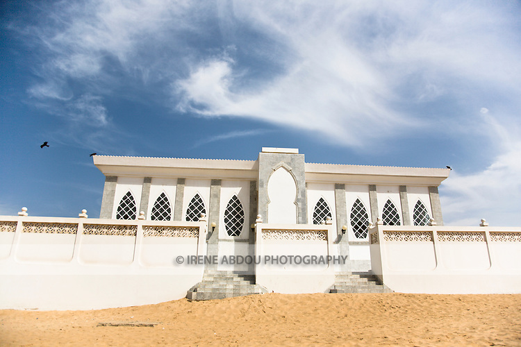"""The Seydina Limamou Laye Mausoleum sits on the coast of Senegal in the fishing village of Yoff.  Seydina Limamou Laye (1843-1909) was the founder of the Layène (meaning """"partisans of God"""") brotherhood."""