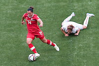 June 21, 2015: Melissa TANCREDI of Canada controls the ball during a round of 16 match between Canada and Switzerland at the FIFA Women's World Cup Canada 2015 at BC Place Stadium on 21 June 2015 in Vancouver, Canada. Canada won 1-0. Sydney Low/Asteriskimages.com