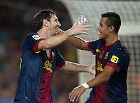 FUSSBALL  INTERNATIONAL  PRIMERA DIVISION  SAISON 2011/2012   23.08.2012 El Clasico  Super Cup 2012 FC Barcelona - Real Madrid  JUBEL Barca; Torschuetze zum 2-1 Lionel Messi (li) umarmt vonAlexis Sanchez