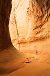 A canyoneer makes her way through Leprechaun Canyon, Utah.