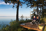Robert and Glynda enjoy the first evening on their new deck along Marine Drive, overlooking Dungeness Lagoon and Spit, on a spectacular spring day.
