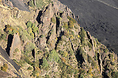 Volcanic dikes or planar sheets of magma intrusions exposed by erosion on Valle del Bove, Mount Etna Volcano, Italy.