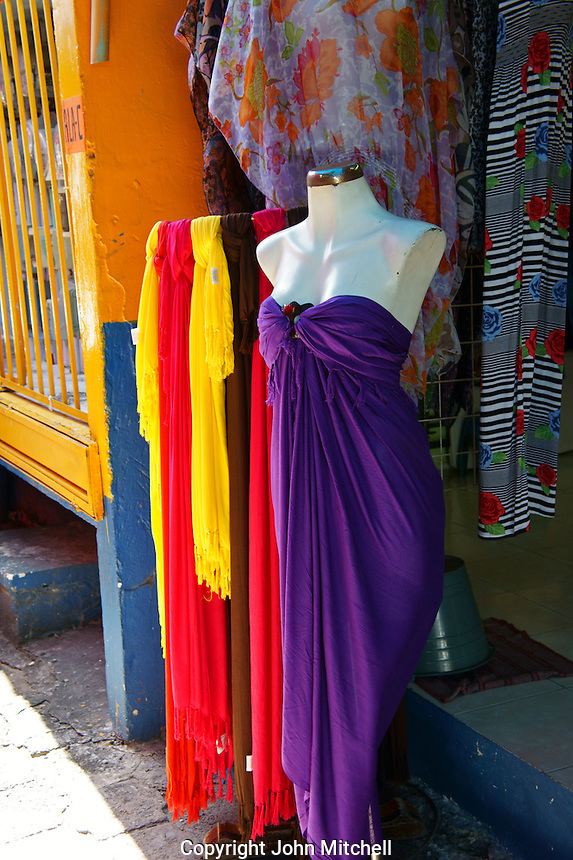Colorful women's clothing in Mercado 28 souvenirs and handicrafts market in  Cancun, Mexico      .