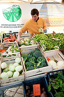 Organically produced fruit and vegetables for sale at the 'Altra Domenica' organic markets, in the meatpacking district of Testaccio, Rome, Italy