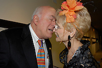 A man delivers a kiss at a benefit in Chicago, Illinois.