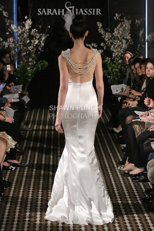 Model walks runway in a Charm wedding dress by Sarah Jassir, for the Sarah Jassir Fall 2011 - Desire bridal collection.