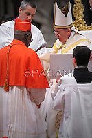 Burkina Faso cardinal Philippe Nakellentuba Ouedraogo receives his beret as he is being appointed cardinal by Pope Francis  at the consistory in the St. Peter's Basilica at the Vatican on February 22, 2014.