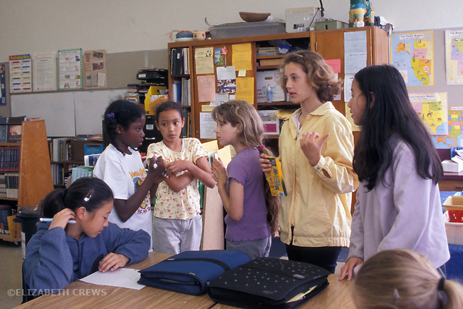 Berkeley CA 5th grade girls in class, showing different rates of growth at the age, around eleven-years old