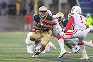 Annapolis, MD - October 8, 2016: Navy Midshipmen running back Toneo Gulley (2) gets tackled by a Houston Cougars defender during game between Houston and Navy at  Navy-Marine Corps Memorial Stadium in Annapolis, MD.   (Photo by Elliott Brown/Media Images International)