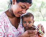 "Young Wayuu indigenous woman and her baby in a ""rancheria"", or traditional rural settlement, in La Guajira, Colombia."